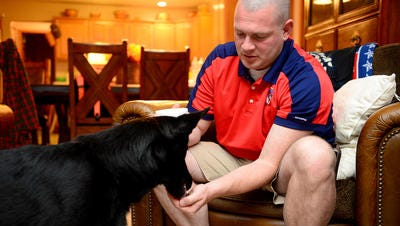 Johnnie Trout and his service dog, Raven, were refused entrance to a Holt gym.