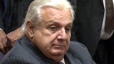 A court has upheld the termination of two Middlesex County Sheriff Office investigators for giving brides to former Sheriff Joseph Spicuzzo to obtain jobs.