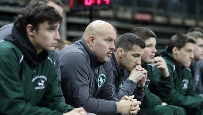 South Plainfield coach Kevin McCann watches the Tigers semifinal match against Delsea at the State Group Team Wrestling Championships, Sunday, February 15, 2015, at the Sun Bank Arena in Trenton, NJ.