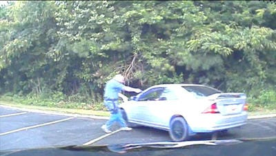 Image from a dash cam video of Seneca Police Lt. Mark Tiller shooting and killing 19-year-old Zachary Hammond during an attempted drug bust.