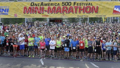 Wave 2 runners get ready to start the 500 Festival OneAmerica Mini Marathon Saturday, May 7, 2016, morning downtown Indianapolis.
