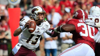 Smith (13) made 10 starts at quarterback for ULM last year as a redshirt freshman before missing the final three games of the season with a shoulder injury.