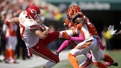 Chiefs tight end Travis Kelce (left) is among former UC players in NFL camps this preseason.