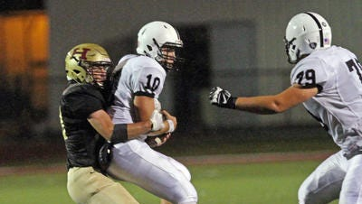 Bridgewater-Raritan quarterback Eric Nickel (right) is sacked by Hillsborough's Jack Edwards during the first quarter on Oct. 6, 2015.
