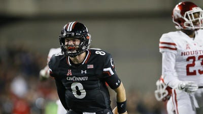 Quarterback Hayden Moore and the Cincinnati Bearcats seek their first AAC win of the season this week against East Carolina.
