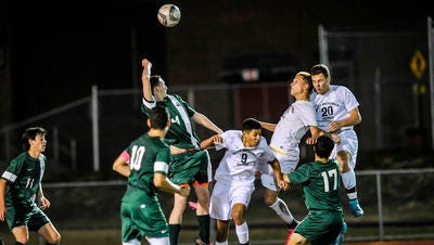 South Brunswick's Kevin Nunez (center), Patrick Grudnik, and Jarett Kean go up for a head ball with South Plainfield's Ian McCoid in the GMC Tournament final at Woodbridge on Oct. 31, 2015.