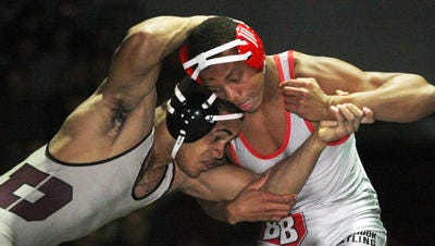 Bound Brook's George Walton (right) grapples with Phillipsburg's Yann Ondele during their 182-pound bout on Jan. 21, 2015.