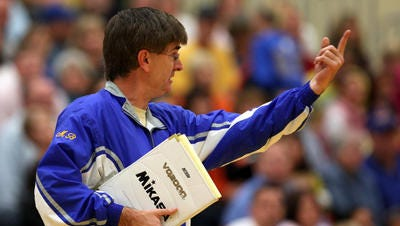Steve Shondell coaches Burris during a match against Yorktown in 2009. Shondell led Burris to 21 state championships.