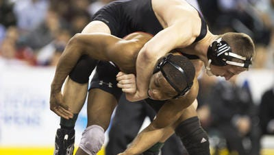 Bound Brook's Mekhi Lewis (bottom) wrestles Hasbrouck Heights' Michael O'Malley at 145 pounds at the NJSIAA State Tournament final on March 6, 2016.