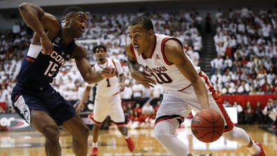 Senior guard Troy Caupain knows the Cincinnati Bearcats will face a tough environment Sunday at SMU: 'It feels like the crowd is just over the top of you.'