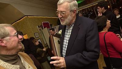 George Million (right) jokes with former employee Keith Smith during Million's retirement party in 2005.