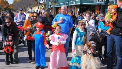 Costumed characters at Main and Ann Arbor Trail in downtown Plymouth during the 2014 Pumpkin Palooza. This year's event is from noon to 3 p.m. Sunday.