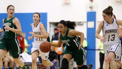 East Brunswick's Nicole Johnson leads the charge to the basket during the second quarter against Monroe during the GMC Tournament final on Feb. 25, 2016.