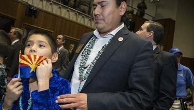 Arizona Rep. Eric Descheenie, with son, Sequoyah, 10, on opening day of the Legislature.
