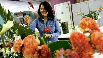 In this file photo, an area florist prepares arrangements.