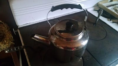 A teakettle sits atop the wood-burning stove at author Jerry Apps' cabin.
