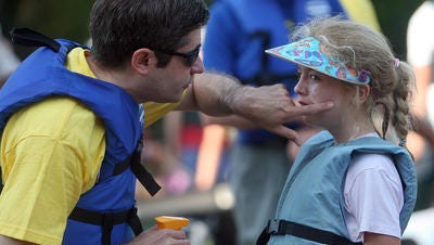U.S. sunscreens, like the one this dad put on his daughter at Paddlefest in 2009, need to be as strong as those in Europe and Canada, some members of Congress say.
