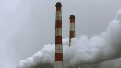Emissions spew out of a large stack at the coal fired Morgantown Generating Station, on May 29, 2014 in Newburg, Maryland.