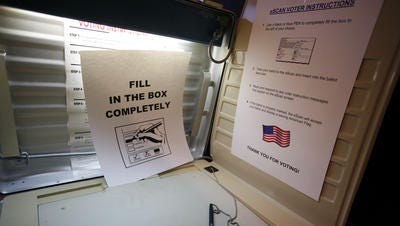 The inside of a voting booth