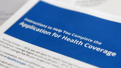 """Application and instructions paper work for the Health Insurance Marketplace from the Department of Health and Human Services as part of the Affordable Care Act, more popularly known as """"Obamacare,"""" is seen as it was released Tuesday, Oct. 1, 2013"""