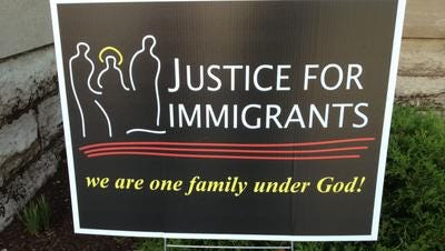 A sign outside Holy Family Church welcomes people to a special Mass in support of immigration reform.