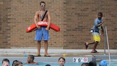 Lifeguard Jack McLaughlin, 16, at Pleasant Ridge Recreation Center pool last summer.