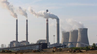 Fumes from burning coal rise to the sky at the TVA Paradise power plant in Drakesboro on the Green River. Construction is underway for a natural gas-fueled facility to be operational by 2017.
