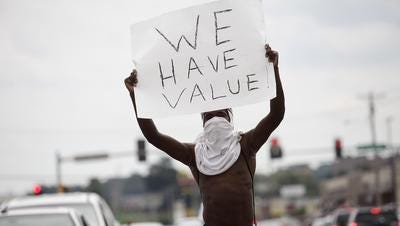 A man protests the death of Michael Brown in Ferguson, Mo.