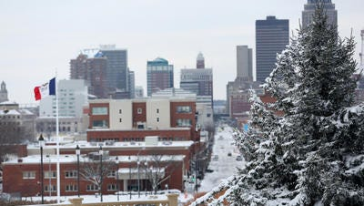 A fresh blanket of snow graced Des Moines just in time for the holiday season. The Iowa State Capitol tree shows beauty in its details in this view overlooking East Village.