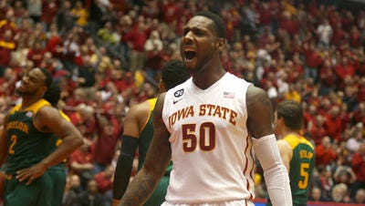 Iowa State senior DeAndre Kane launches reacts to the crowd's cheer after he hit a three-point field goal against Baylor on Tuesday, Jan. 7, 2014, at Hilton Coliseum in Ames, Iowa.