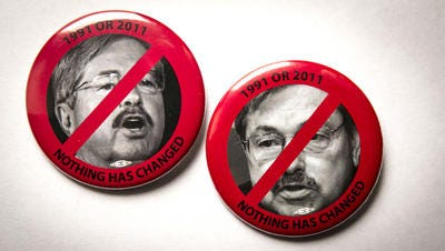 Gov. Terry Branstad's administration says this pin -- if worn by state prison employees -- would jeopardize public safety.