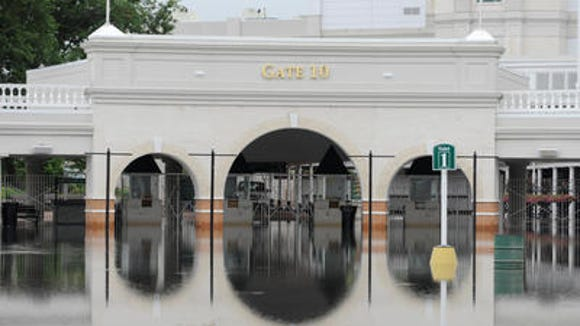 Heavy rain made a lake of Gate 10 at Churchill Downs on Aug. 4, 2009.
