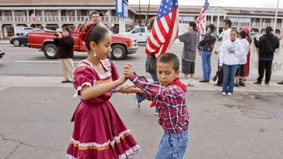 Children dance during an immigration protest in Phoenix.