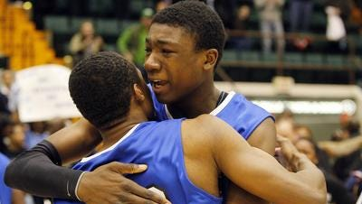 Thomas Bryant hugging a teammate after Bishop Kearney won the 2013 Class AA boys basketball public school state championship.