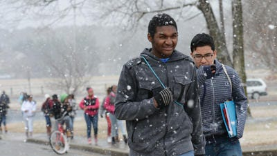 This Feb. 9, 2015, photo shows Jovon Young, left, and Anderson Sanchez of Salisbury walking home in the snow from Wicomico Middle School. February snowfall closed schools in the region for several days.