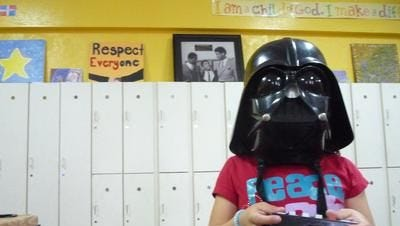 Kiara Morales, 7, wears a Darth Vader mask during her after-school program at the Don Bosco Community Center in Port Chester May 24, 2012. The center had to cut back its after-school hours after a holdup in federal community development funds—a result of the dispute over the Westchester County affordable housing settlement.