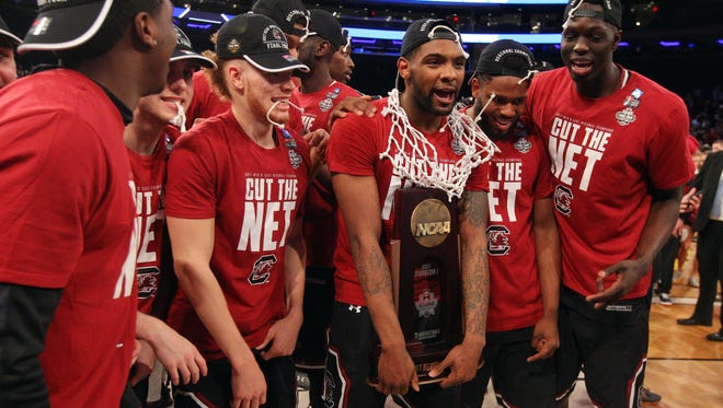 The South Carolina Gamecocks celebrate with the East Regional trophy after beating the Florida Gators at Madison Square Garden on March 26, 2017.
