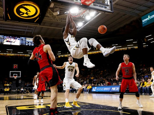 Iowa forward Tyler Cook dunks on Belmont Abbey in Thursday's Hawkeye exhibition victory. It was a common sight, as the Crusaders had no answer for Cook.