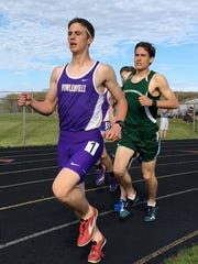 Fowlerville's Chris Davis (front) was 15th in the state Division 2 track and field meet in the 3,200 last season.