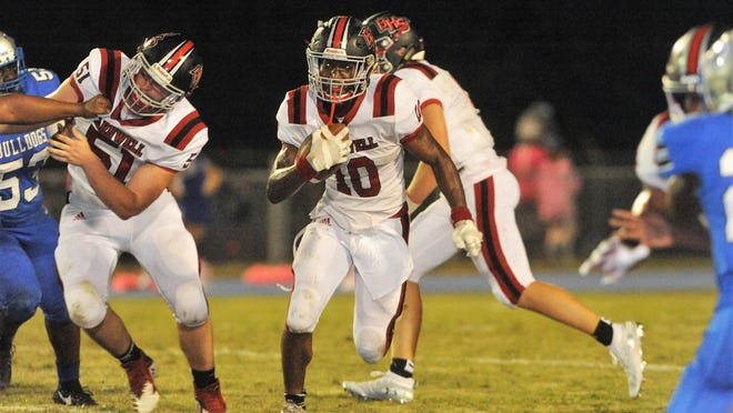 Warhorse offensive lineman Chris Hammet, #51, clears an opening for tailback CJ Ransom.