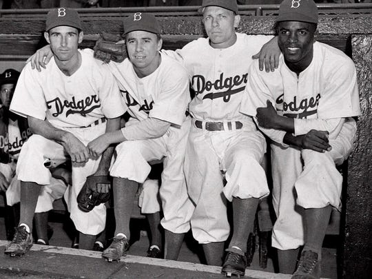 Jackie Robinson, right, will be the subject of a movie screening at 7 p.m. Feb. 7 at First Congregational Church. Admission is free.