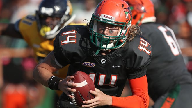 FAMU's Ryan STanley Scrambles out of the pocket against N.C. A&T at Bragg Memorial Stadium Saturday, Oct. 14, 2017.