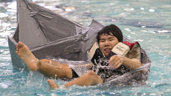 """Desert Vista's Sunjwong Park and his boat called """"Titanic"""" begin to sink on May 4, 2017 at Kiwanis Park and Recreation Center in Tempe, Ariz. The engineering completion asked students to make boats from cardboard and duct tape and race across the pools."""