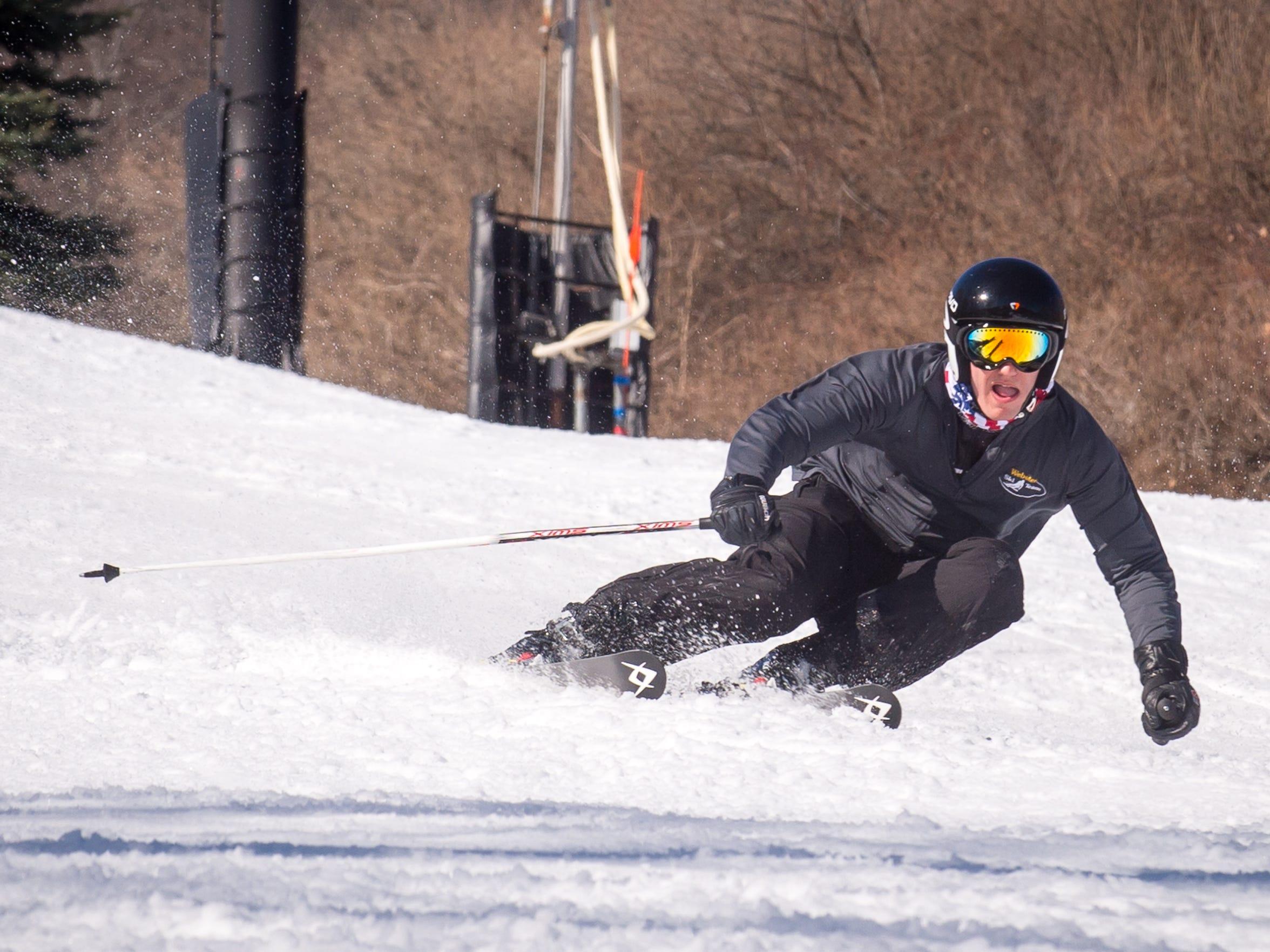 Webster Thomas senior Joe Vasile skis down one of the hills at Bristol Mountain on Feb 20.