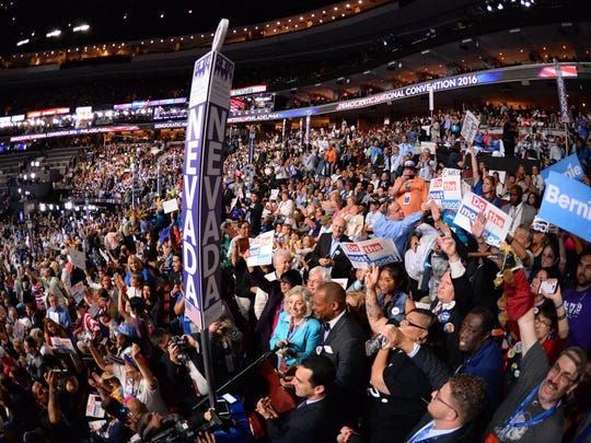 Nevada delegates cheer as they cast their votes during
