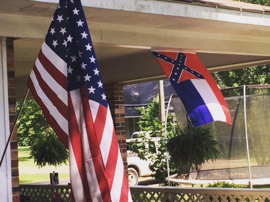 Flags flying outside Heard's home in Lexington.