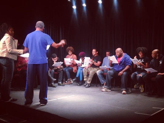 """Chantal Jean-Pierre of North Brunswick, representing Crosroads Theatre Company, in a rehearsal for one of the pieces in the """"Every 28 Hours"""" project in St. Louis. Directing in blue shirt is Ron Himes, founder and producing director of The Black Rep in St. Louis."""