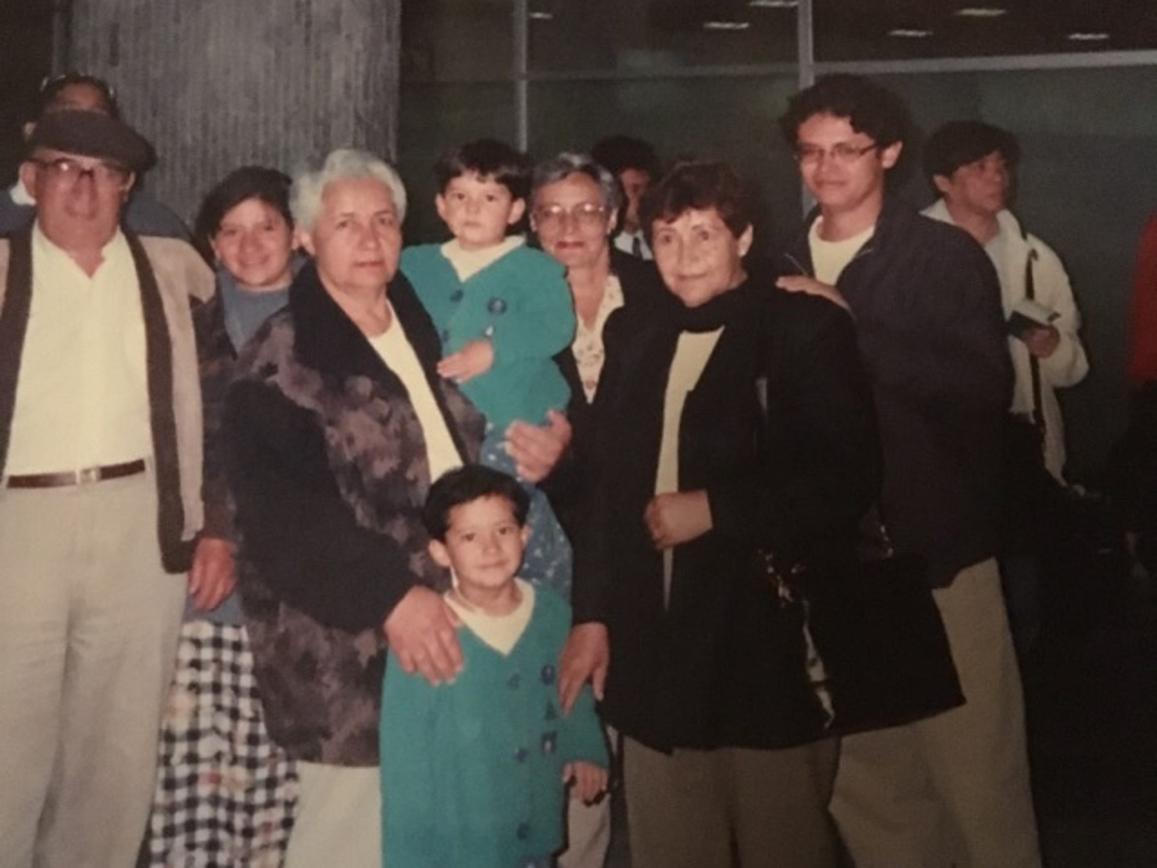 The whole extended family surrounds the Rodriguez family at the airport before they immigrate to the U.S.