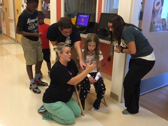 C.S. Mott Children's Hospital staff playing Pokémon