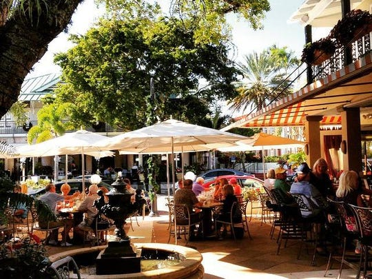 Open air dining by Campiello's fountain in downtown Naples.